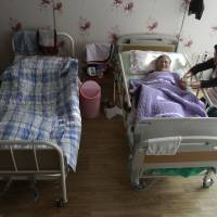 Safe place: Kim Jong-boon receives care at the House of Sharing, a nursing home for former 'comfort women' in Toechon, South Korea, last year.   AP