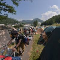 Road to Fuji: People arrive for the Fuji Rock Festival in 2012. Japanese music festivals have a reputation for being very well-organized. | HIRO IKEMATSU