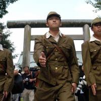 The doctor will see you now: Japanese nationalists dressed in World War II military uniforms march into Yasukuni Shrine in Tokyo on Aug. 15, 2005, the 60th anniversary of the end of the conflict.   ANDY RAIN / BLOOMBERG