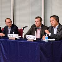 Panelists answer questions at a symposium titled 'Corporate Competitiveness from an International Viewpoint,' organized by the Keizai Koho Center in Tokyo on June 5. | SATOKO KAWASAKI