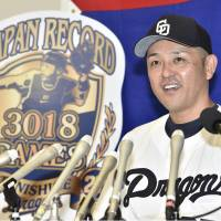 Chunichi Dragons player-manager Motonobu Tanishige on Tuesday speaks to the media after appearing in his 3,018th game at Nagoya Dame. Tanishige  set the record for most games played in Nippon Professional Baseball. | KYODO
