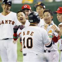 The CL All-Stars celebrate Shinnosuke Abe's tiebreaking homer in the sixth inning on Friday. | KYODO