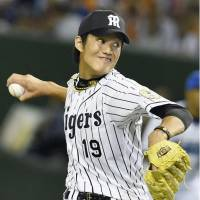 Tigers pitcher Shintaro Fujinami earned Game 1 MVP honors after retiring all nine batters he faced on Friday. | KYODO