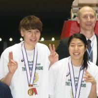 Tom Hovasse and Ramu Tokashiki (left) are seen after JX-Eneos won the All-Japan Championship at Yoyogi National Gymnasium in December 2014. | KAZ NAGATSUKA