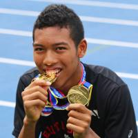 Abdul Hakim Sani Brown poses for photographs on Saturday. Sani Brown won gold in the 100 and 200 meters at the IAAF World Youth Championships earlier this month. | KAZ NAGATSUKA