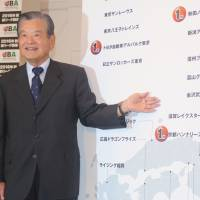 JBA president Saburo Kawabuchi unveils the first wave of teams who will play in the JPBL when the first season tips off in 2016-17 at a news conference on Thursday in Tokyo. | KAZ NAGATSUKA