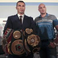 World champion boxer Vladimir Klitschko (left), seen posing with British challenger Tyson Fury during a recent news conference in Duesseldorf, Germany, to promote their October bout, has the combination of build and athleticism that represents the prototypical heavyweight these days. | REUTERS