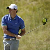 Soccer injury puts McIlroy's British Open title defense in doubt