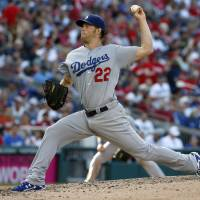 Kershaw fans 14 as Dodgers salvage split