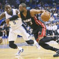 Heat keep Wade for one more season with $20 million deal
