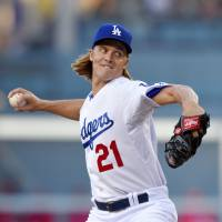 Greinke extends scoreless streak