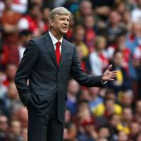 Wenger content to carry on