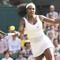 Serena Williams plays a shot from Heather Watson during their third-round match at Wimbledon on Friday. Williams won 6-2, 4-6, 7-5. | REUTERS
