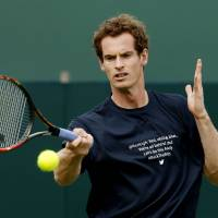 Murray admits being down after loss to Federer