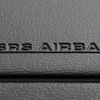The air bag on the passenger side of a Toyota car is seen at the company's Tokyo showroom in April 2013. | BLOOMBERG