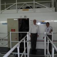 Haruo Ezuka, the president of Pan Am International Flight Academy, and Gary Anderson, its chief operating officer, stand in front of a flight simulator at the school in Miami on June 10. | KYODO
