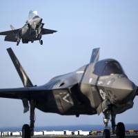 Two U.S. Marine F-35B Lightning II Joint Strike Fighters complete vertical landings aboard the USS Wasp during operational testing in May. | REUTERS
