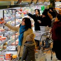 Prices of food and other products edge higher from a year ago. | BLOOMBERG