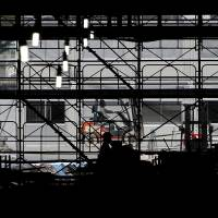 A worker drives a forklift at a construction site in Tokyo on Wednesday. Core machinery orders fell 7.9 percent in June, data released Thursday showed. | REUTERS