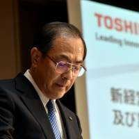 Toshiba President Masashi Muromachi announces a new management lineup Tuesday at the company's headquarters in Tokyo. | AFP-JIJI