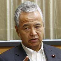 Akira Amari, minister in charge of the TPP negotiations, gestures during an interview Friday. | KYODO