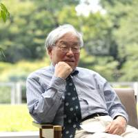 Koichi Hamada, special adviser to Prime Minister Shinzo Abe, says Japan 'need not worry' about China's devaluation of the yuan because it can always offset the effects through monetary easing policy. | BLOOMBERG