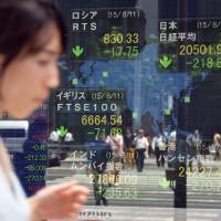 Tokyo stocks fell 1.09 percent in morning trading Wednesday after China devalued its currency for the second day in a row, aggravating worries about the strength of the world's No. 2 economy. | AFP-JIJI