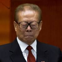 China party says no disrespect meant with Jiang sign removal
