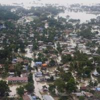 An aerial view shows floodwaters inundating houses and vegetation in Kalay, upper Myanmar's Sagaing region, Relentless monsoon rains have triggered flash floods and landslides, destroying thousands of houses, farmland, bridges and roads. | AFP-JIJI