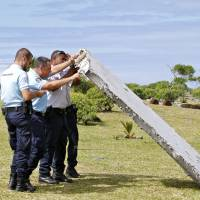 Plane debris raises MH370 families' hopes, without resolution