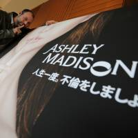 A 2014 file photo shows Noel Biderman, chief executive of Avid Life Media Inc., which operates AshleyMadison.com., posing during a photo session in Tokyo. Hackers claim to have leaked a massive database of users from Ashley Madison, a matchmaking website for cheating spouses. In a statement released Tuesday, a group calling itself Impact Team said the site's owners had not bowed to their demands. 'Now everyone gets to see their data,' the statement said. | AP