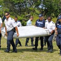Barnacles on wing part may help in hunt for MH370