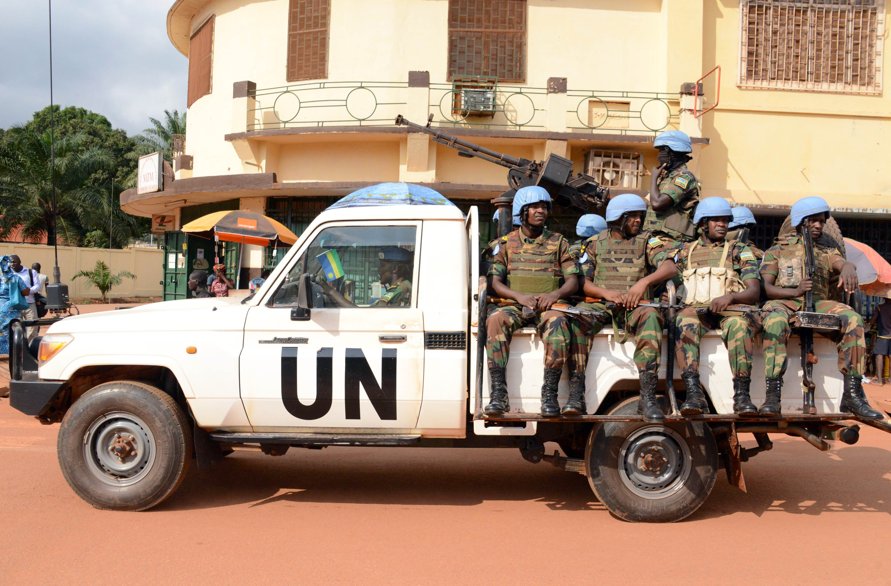 U.N. peacekeeping soldiers from Rwanda patrol in December in Bangui. A Rwandan U.N. peacekeeper in the Central African Republic shot dead four colleagues on August 7 and injured eight others before being gunned down, military sources said. It was the worst such incident to hit the U.N. peacekeeping mission in the country, known by its French acronym of MINUSCA, since it was deployed in September following inter-religious clashes that claimed hundreds of lives. Two deaths and a girl's rape in Bangui have also been blamed on U.N. peacekeepers.   AFP-JIJI