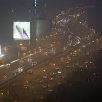 Cars drive on a highway on a hazy night in downtown Shanghai on Jan. 25.   REUTERS