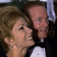 Kathie Lee Gifford and her husband, Frank Gifford, arrive for the wedding of Caroline Mulroney and Andrew Lapham in Montreal, in this file photo taken in September 2000. Frank Gifford, a star on the football field for the New York Giants and later a star in the broadcasting booth as part of the 'Monday Night Football' team that helped popularize the NFL, died on Sunday at the age of 84, his family said in a statement released to NBC. | REUTERS