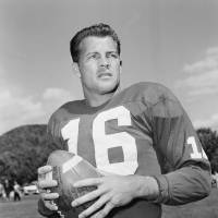 In this Sept. 9, 1958, file photo, New York Giants halfback Frank Gifford participates in a workout in New York. In a statement released by NBC News on Sunday, his family said Gifford died suddenly at his Connecticut home of natural causes that morning. | AP