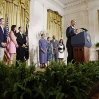 Obama unveils power plant greenhouse gas curbs; Republicans on offensive