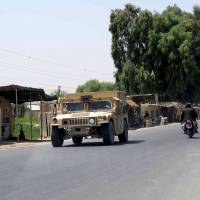 'Insider attack' claims two U.S. soldiers on Afghanistan base; embassy warns of hotel threat