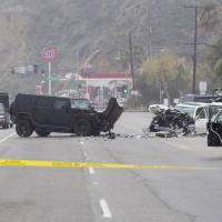 In this Feb. 7 file photo, Los Angeles County Sheriff's deputy guards the scene of a collision involving three vehicles in Malibu. Sheriff's investigators plan to recommend prosecutors file a vehicular manslaughter charge against Caitlyn Jenner for her role in the fatal car crash on the Pacific Coast Highway in Malibu last February. Los Angeles County Sheriff's Department spokeswoman Nicole Nishida says investigators found that Jenner was driving 'unsafe for the prevailing road conditions' because her SUV rear-ended a Lexus, pushing it into oncoming traffic. | AP