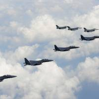 U.S. and South Korean fighter jets are seen flying over the Korean Peninsula on Saturday. Officials from both South and North Korea met later in the day at the truce village of Panmunjom in a bid to ease tensions.   AFP-JIJI