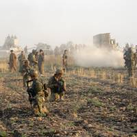 Kurdish peshmerga troops deploy during a military operation to regain control of villages from Islamic State group fighters south of oil-rich city of Kirkuk, 180 miles north of Baghdad, Wednesday. | AP