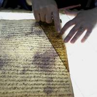A member of the library restoration staff works on a damaged document at the Baghdad National Library in Iraq. As the Islamic State militants now set out to destroy Iraq's history and culture, including irreplaceable books and manuscripts kept in the militant-held city of Mosul, a major preservation and digitization project is underway in the capital to safeguard a millennia worth of history.   AP