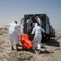 Seven bodies found on Libya beach after refugee boat sinks: Red Crescent