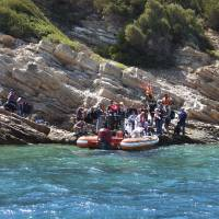 In this photo provided by the Bodrum Sea Rescue Association and taken on Monday, migrants stranded on an inhabited islet are approached for rescue by members of the Bodrum Sea Rescue Association, close to the town of Bodrum, Turkey. The migrants, who were trying to cross in dinghies from the Bodrum area to the nearby Greek islands, abandoned their effort and found refuge on the islet, where they had to be rescued by the Turkish Coast Guard and members of the Bodrum Sea Rescue Association. | BODRUM SEA RESCUE ASSOCIATION VIA AP