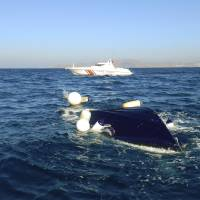 In this image provided by the Bodrum Sea Rescue Association, a capsized motorboat is seen floating in the Aegean Sea, close to the town of Bodrum, Turkey, Tuesday. Six Syrian migrants, including an infant, drowned off the Turkish coast early Tuesday as they tried to reach a Greek island. Divers also rescued a child and two men, all Syrians, alive from a sealed area of the capsized boat, a rescue official said. | BODRUM SEA RESCUE ASSOCIATION VIA AP