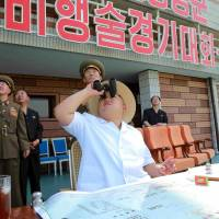 North Korean leader Kim Jong Un watches an aeronautics contest at Kalma Airport in Wonsan in this undated photo released Thursday. | REUTERS