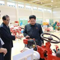North Korean leader Kim Jong Un visits an exhibition of locally made farm machinery in this undated photo. | REUTERS