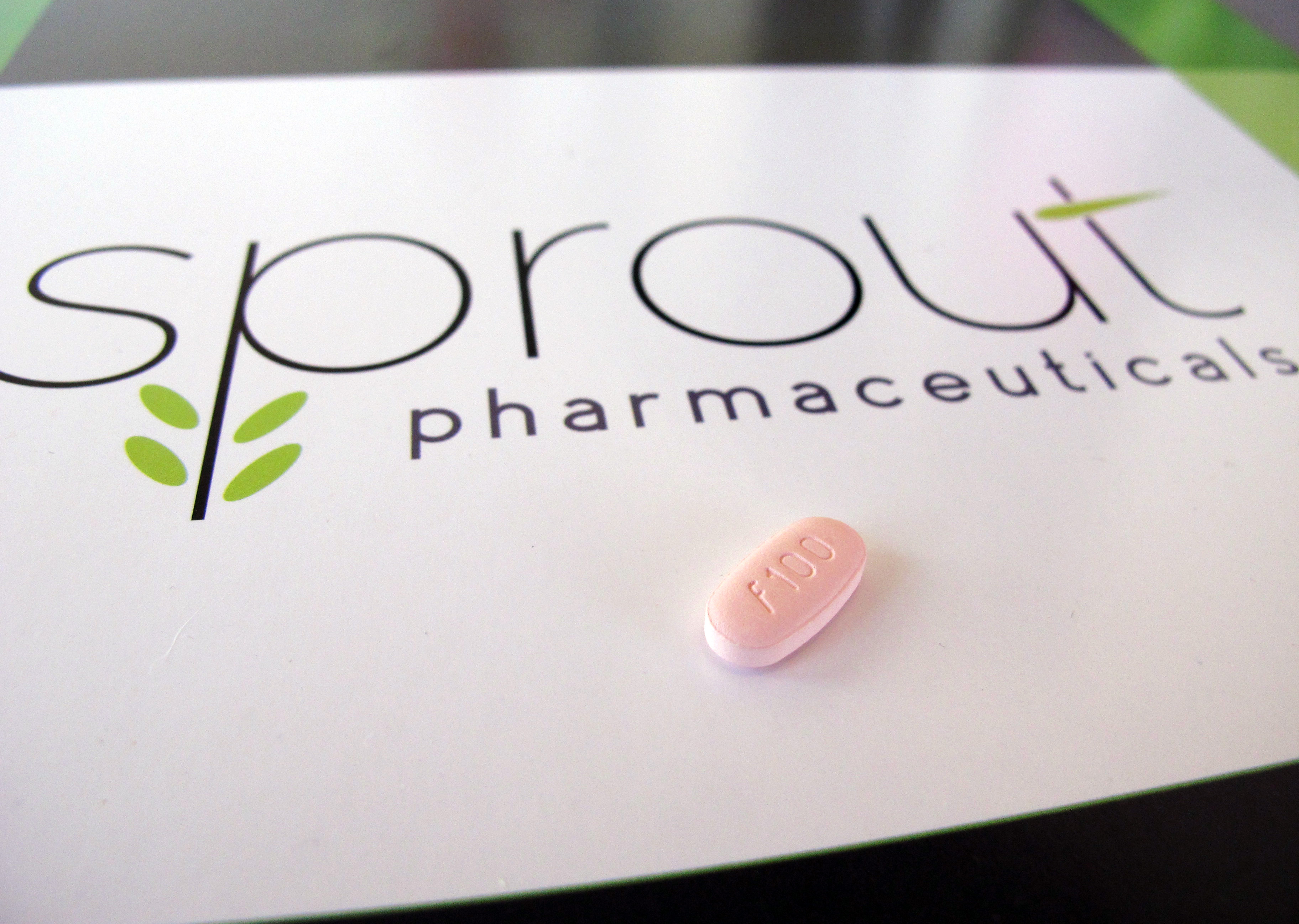 A tablet of flibanserin sits on a brochure for Sprout Pharmaceuticals in the company's Raleigh, North Carolina, headquarters in June. Sprout on Tuesday won Food and Drug Administration approval for flibanserin, dubbed Addyi, the first drug to boost women's sexual desire.   AP