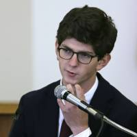 Former St. Paul's School student Owen Labrie scratches his chin while he testifies during his trial at Merrimack Superior Court in Concord, New Hampshire, Wednesday. Labrie is charged with raping a 15-year-old freshman as part of Senior Salute, in which seniors try to romance and have intercourse with underclassmen before leaving the prestigious St. Paul's School in Concord. The defense contends the two had consensual sexual contact but not intercourse. | AP