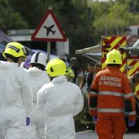 Emergency services and crash investigation officers work at the site where a Hawker Hunter fighter jet crashed onto the A27 road at Shoreham near Brighton, Britain , Sunday. | REUTERS